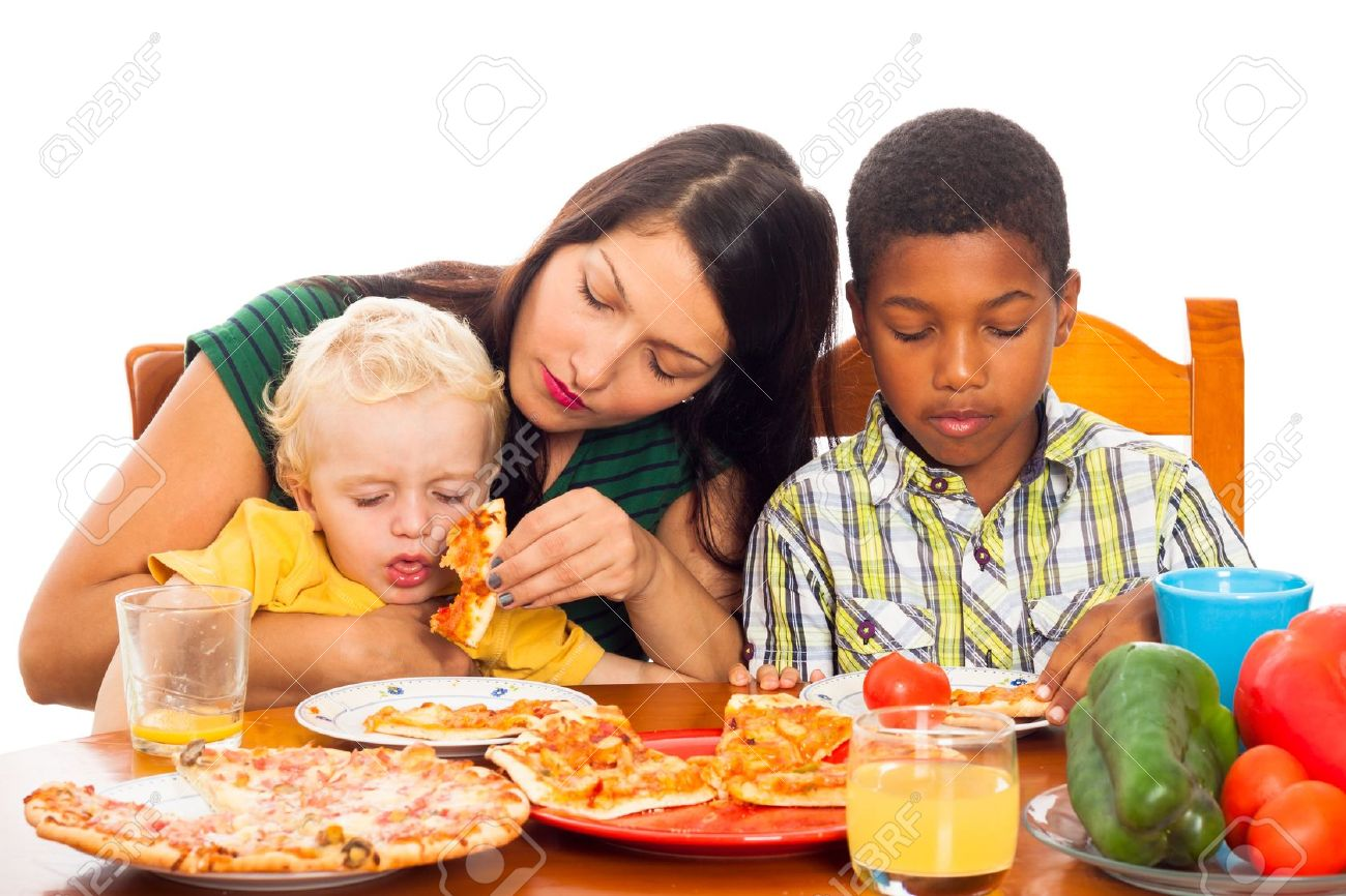 Young woman with kids eating pizza, isolated on white background. Stock Photo - 16960385