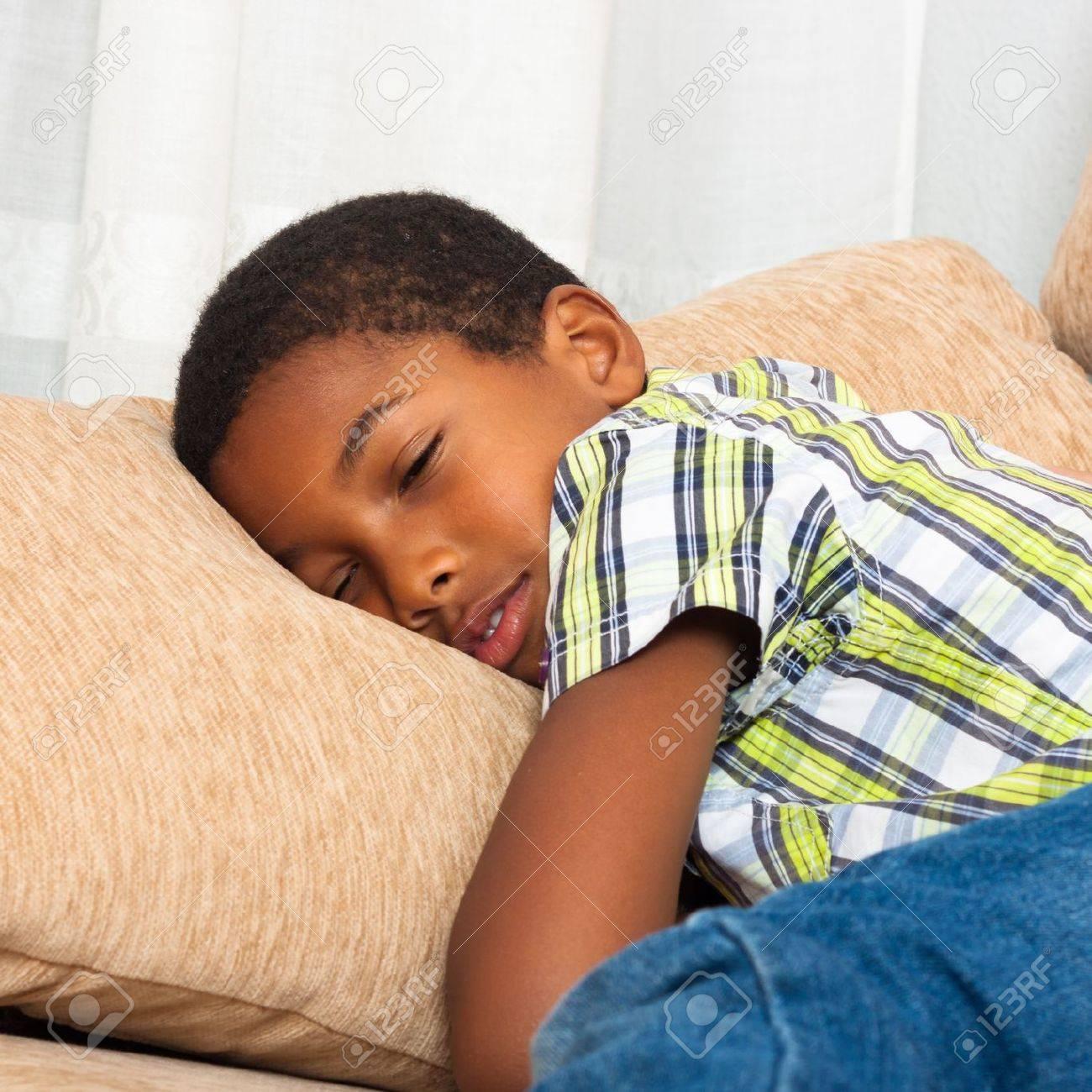 Close up of cute tired child boy sleeping on sofa. - 16960148