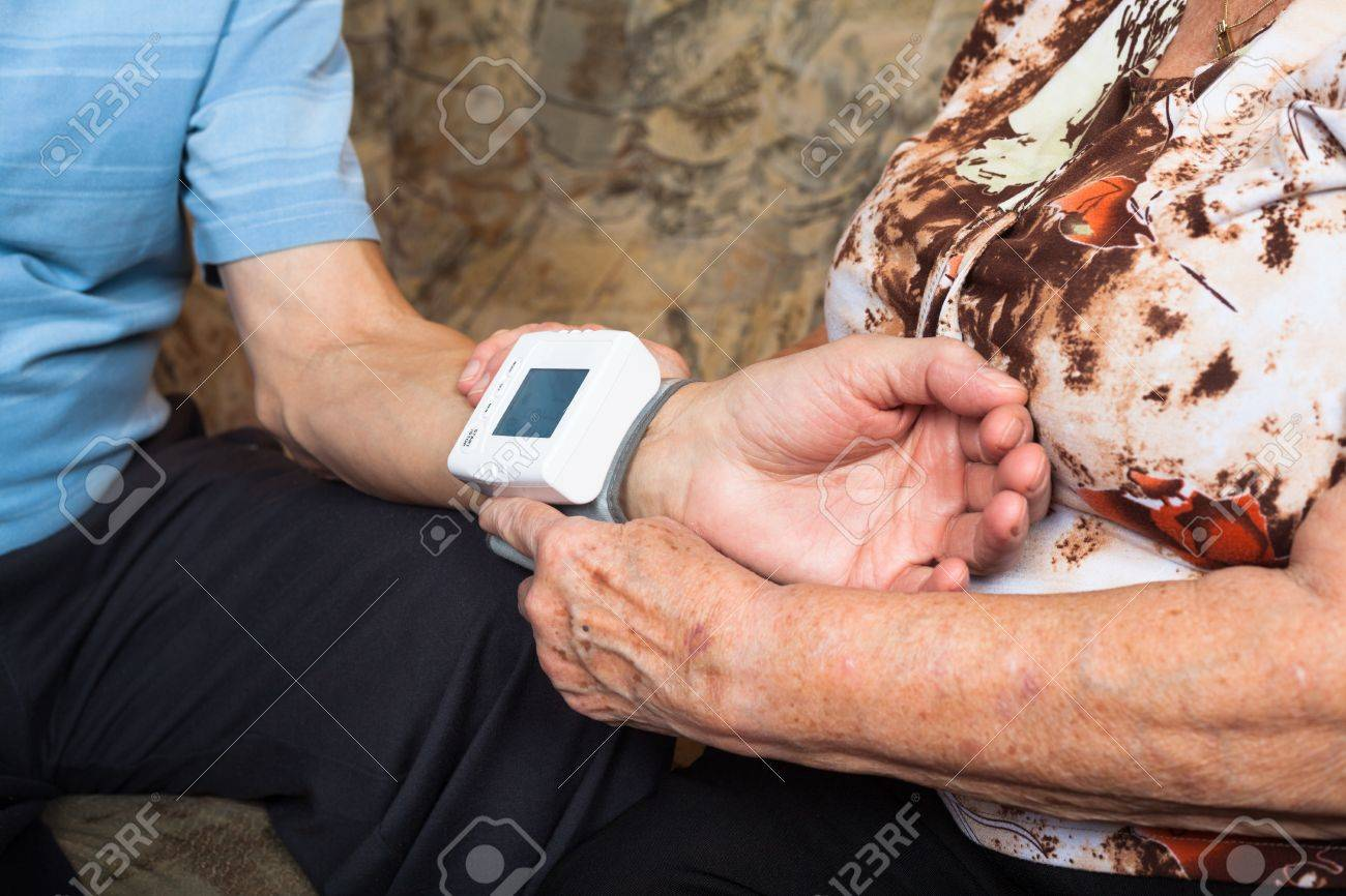 Close up of seniors checking blood pressure. Stock Photo - 17752105