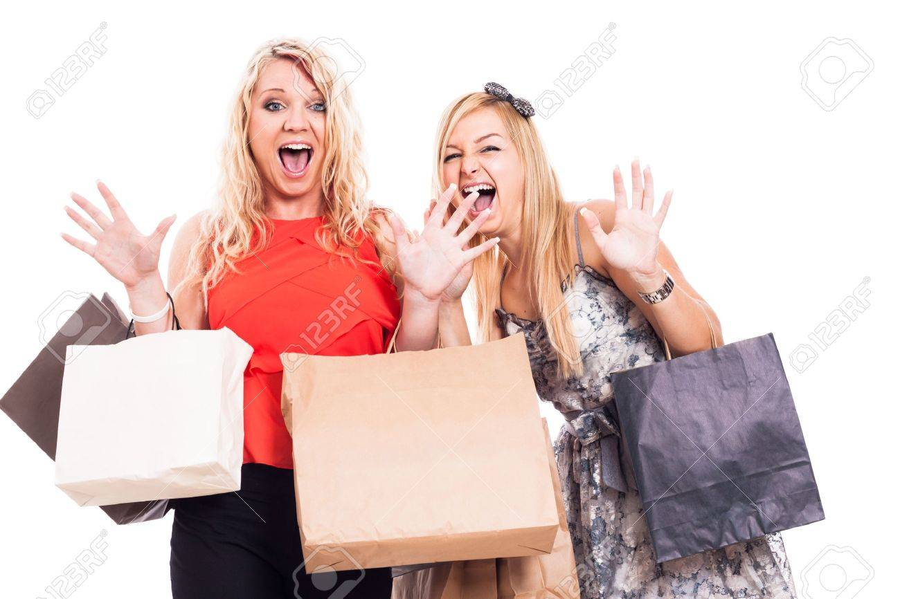 Two crazy blond girls shopping, isolated on white background - 20147089