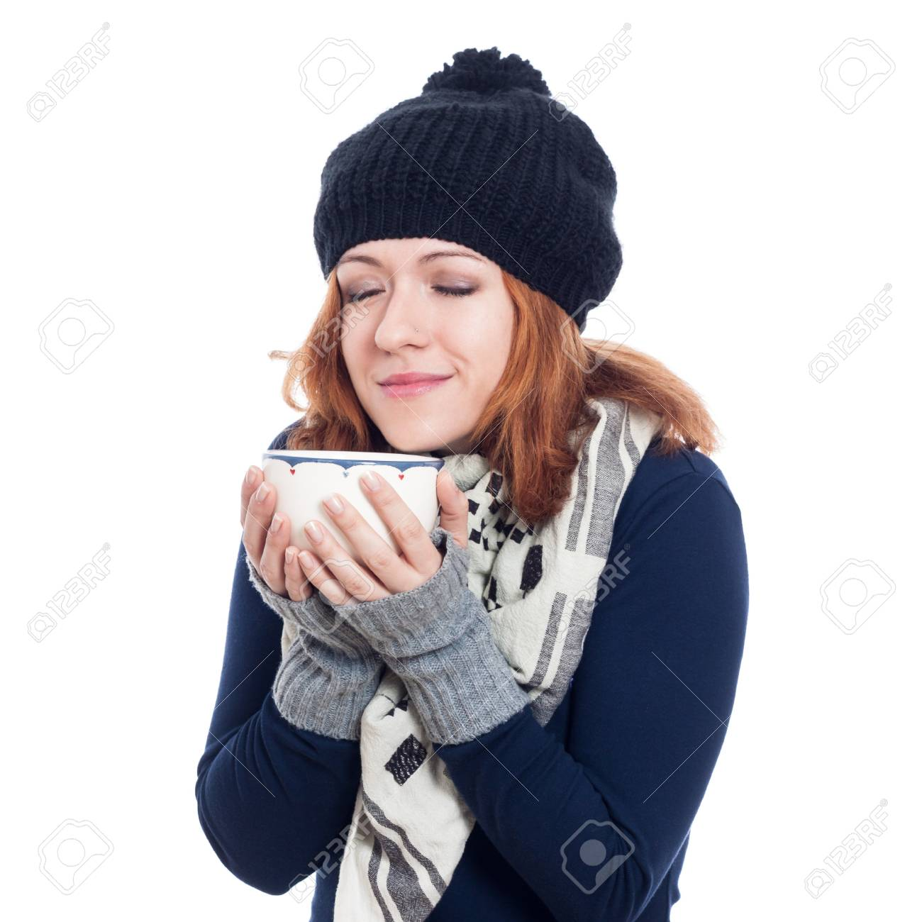 Happy woman in winter clothes enjoying hot drink, isolated on white background Stock Photo - 21579337