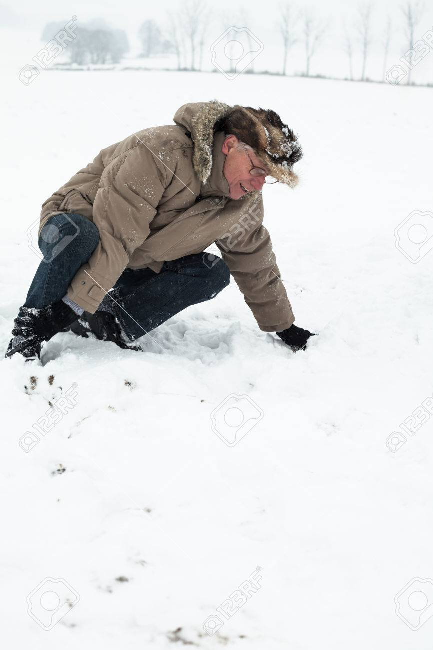 Senior man with injured leg on snow. Stock Photo - 22306163