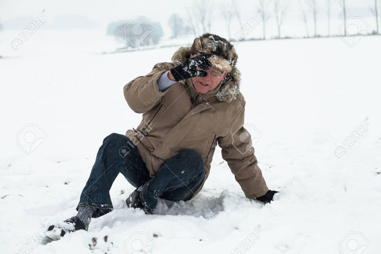 Senior man accident falling on snow in winter. - 22306164