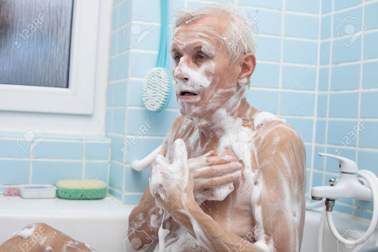 Senior Man Washing His Body With Soap In Bath. Stock Photo   35523126