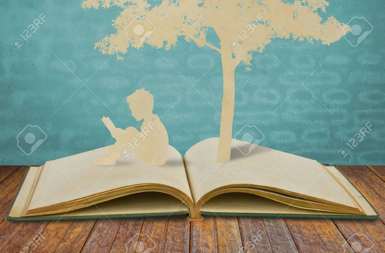Paper cut of children read a book under tree Stock Photo - 10734479