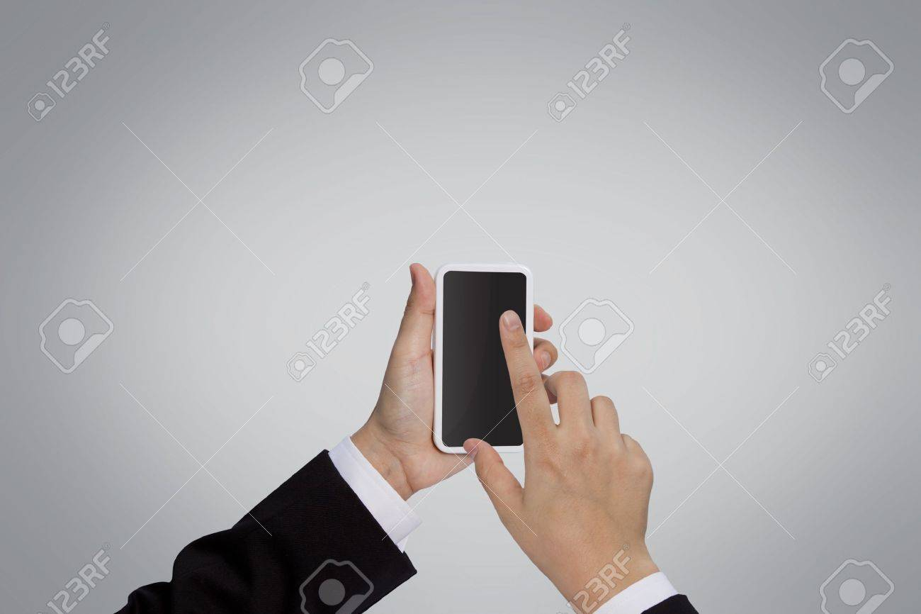 Businessman holding mobile phone Stock Photo - 10901175