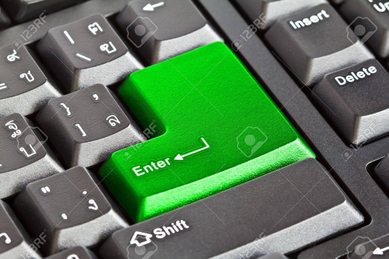 Computer keyboard - Green key Enter, close-up Stock Photo - 11440373