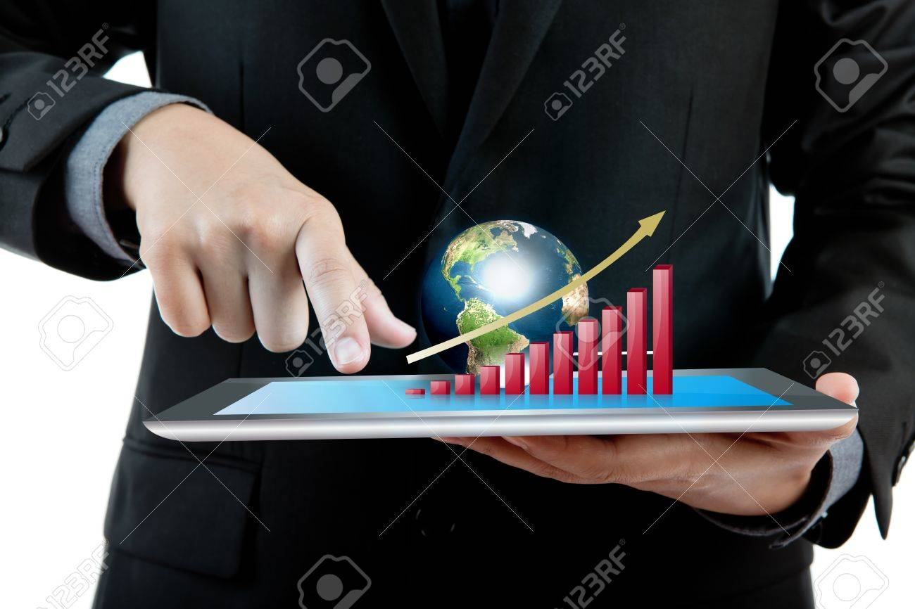 Business man holding the modern digital tablet pc with success growth chart and earth (Elements of this image furnished by NASA) Stock Photo - 13850790