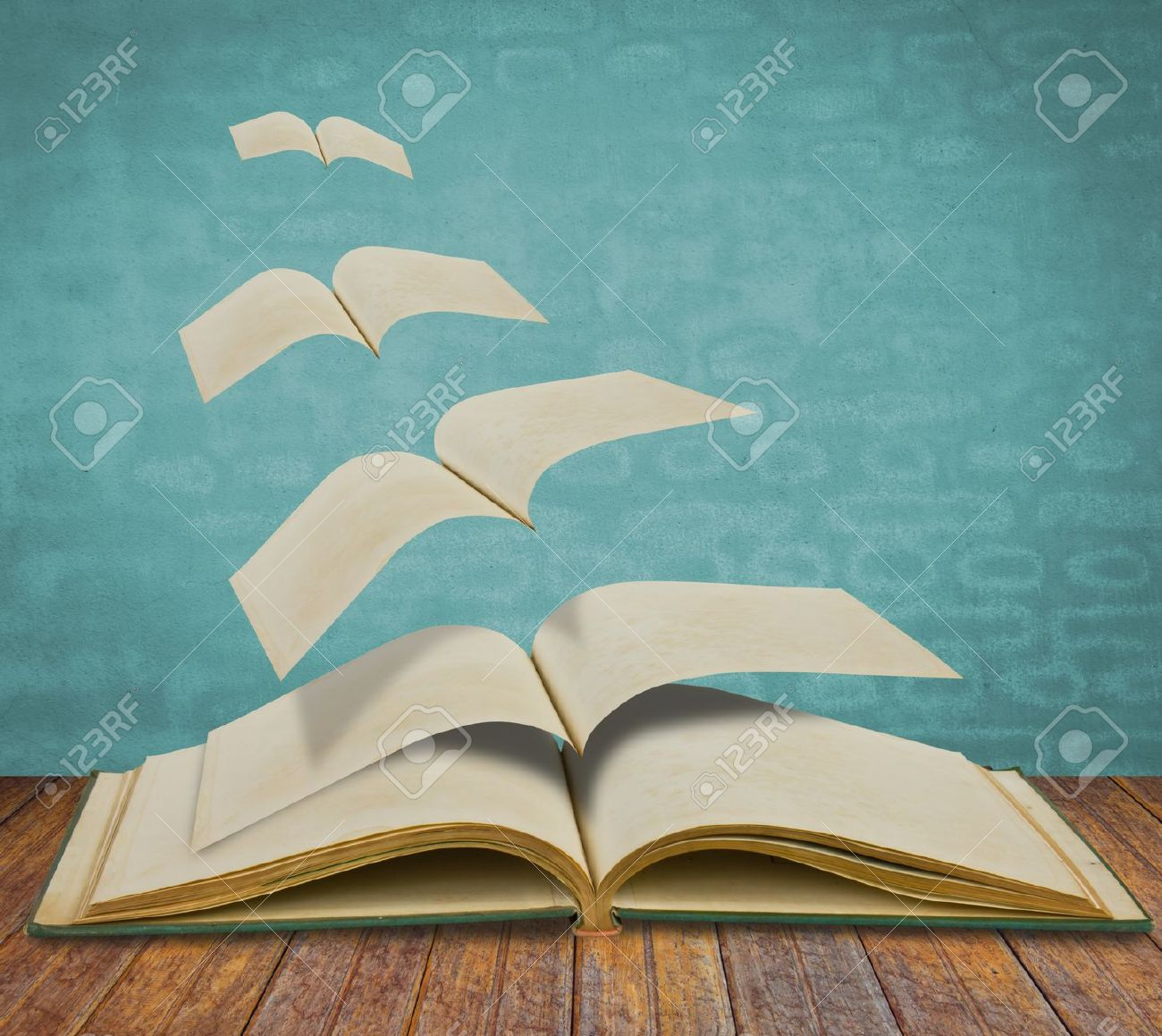 Open flying old books Stock Photo - 14177990