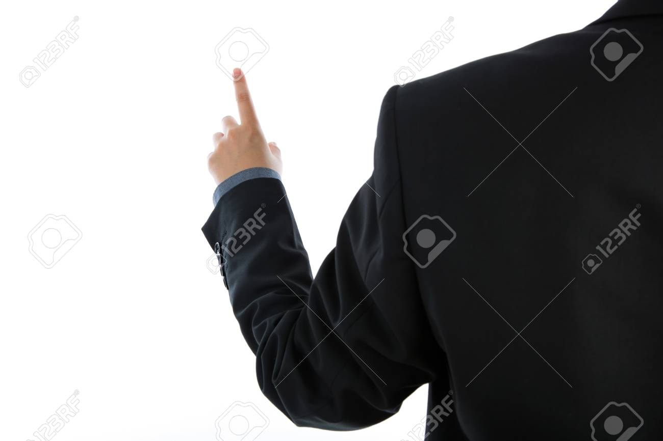 Business man touching an imaginary screen against white background Stock Photo - 15965767