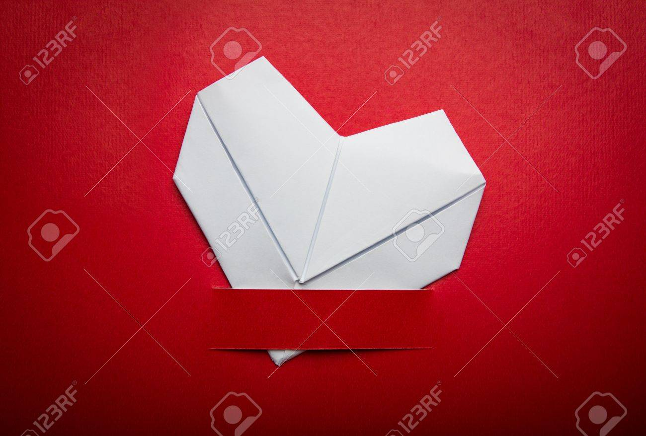 Origami paper heart shape symbol for Valentines day with copy