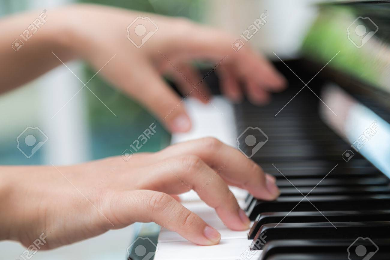 Close up of woman hands playing piano - 42042010