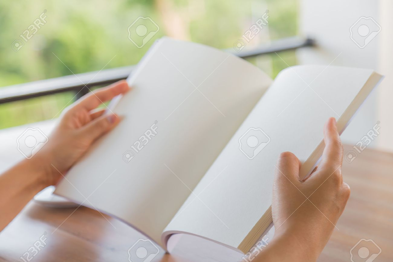 Hands open Blank catalog, magazines,book mock up on wood table with coffee - 42457098