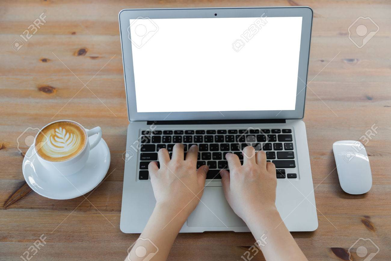 Closeup of business woman hand typing on laptop keyboard and coffee - 42941082
