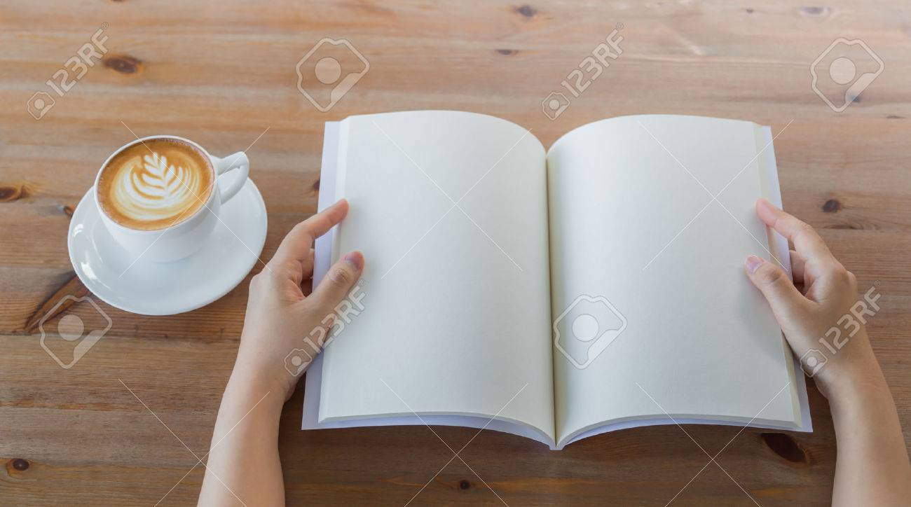 Hands open Blank catalog, magazines,book mock up on wood table with coffee - 42970106