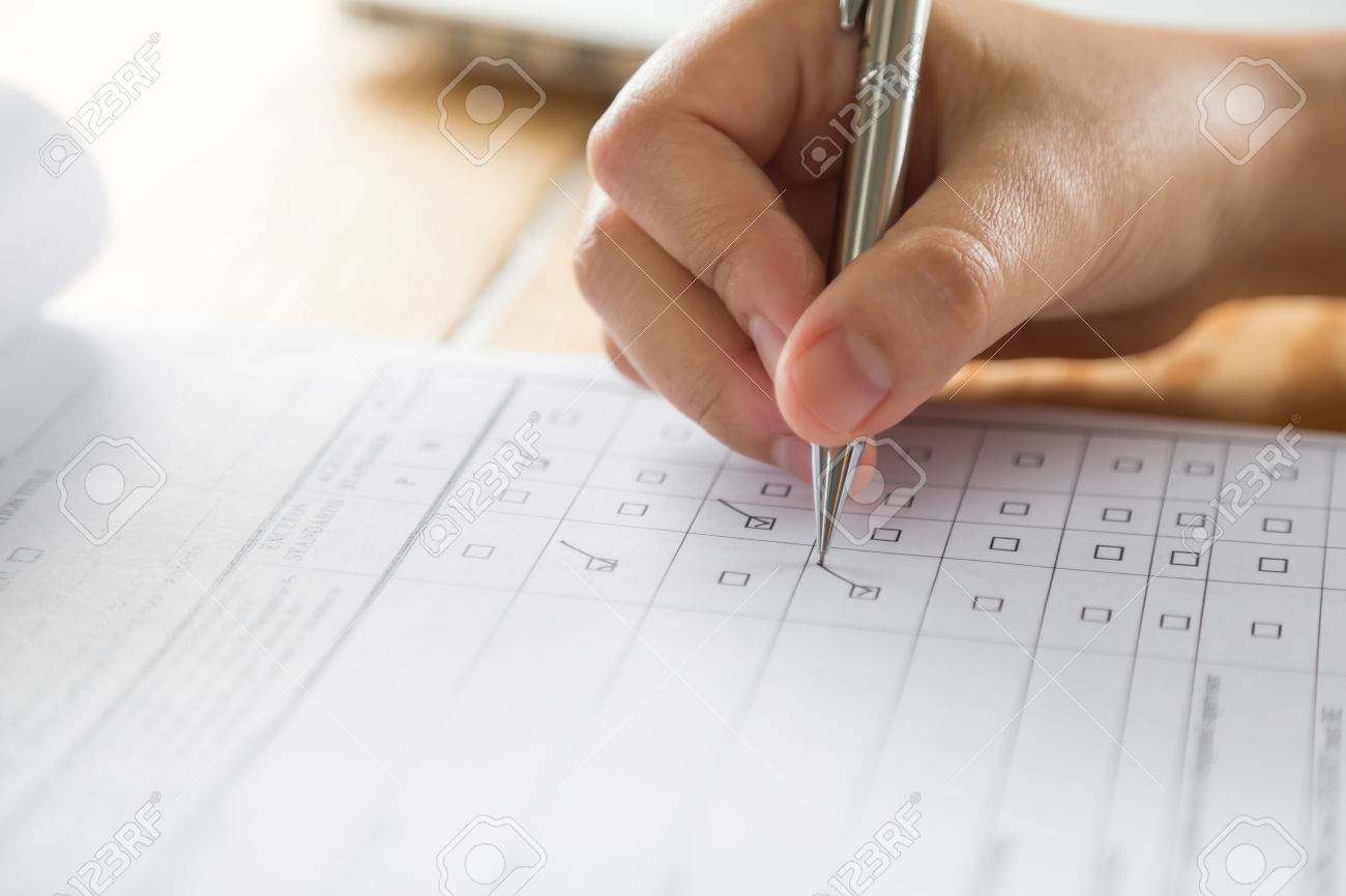 Hand with pen over application form - 47382242