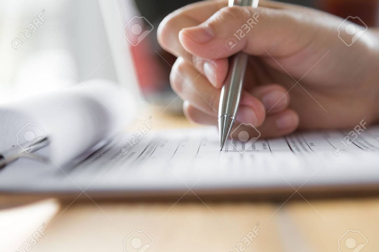 Hand with pen over application form - 48895877