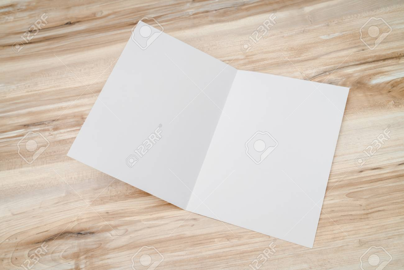 bifold white template paper on wood texture stock photo picture and