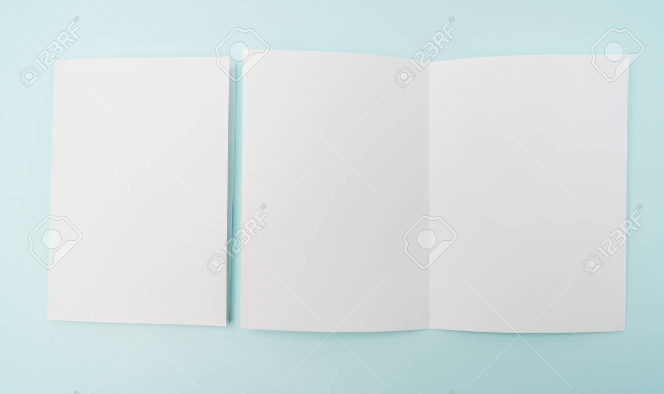 bifold white template paper on blue background stock photo picture