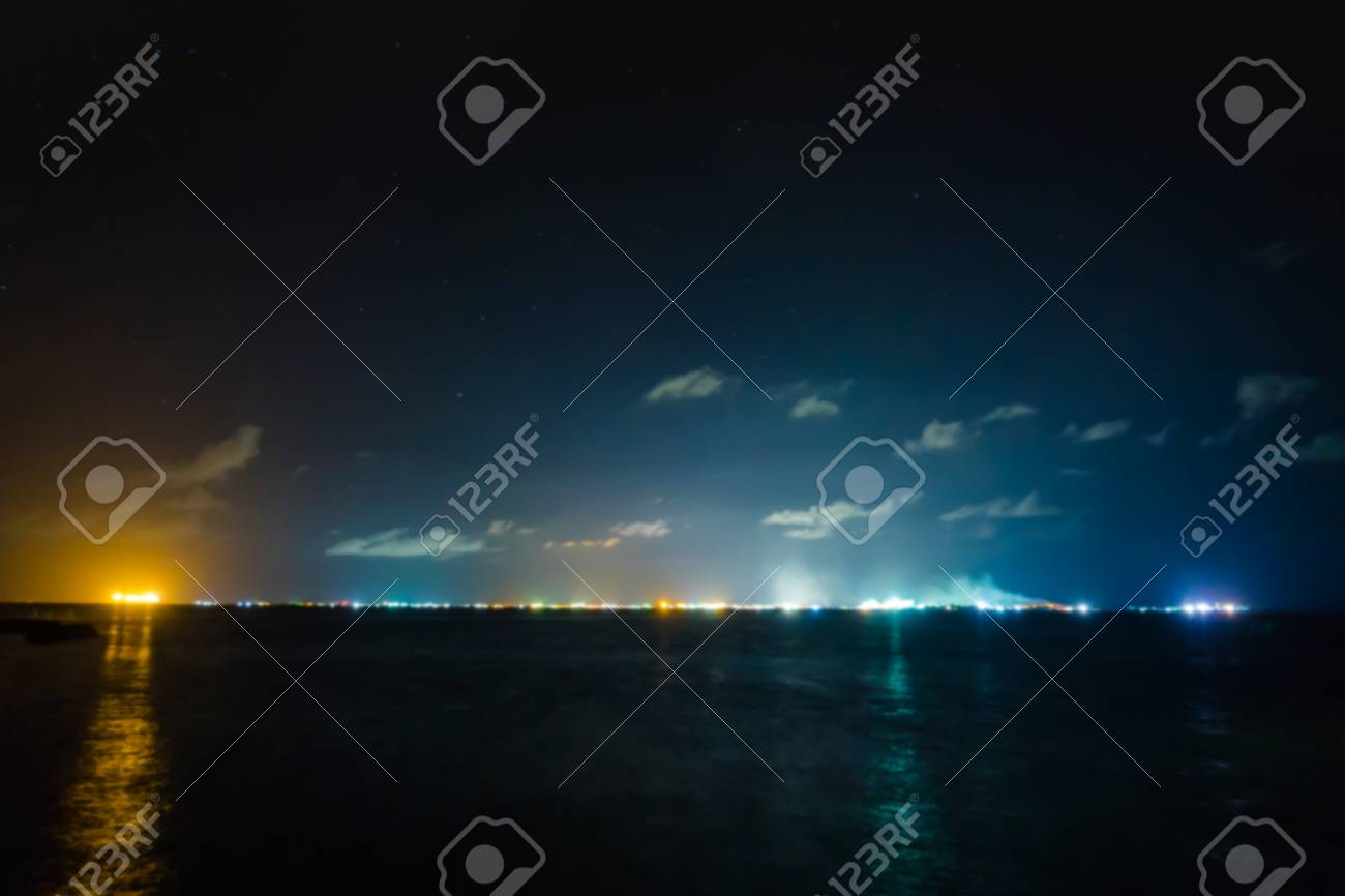 Abstract blur of Skyline Male, Maldives at night with dark sea