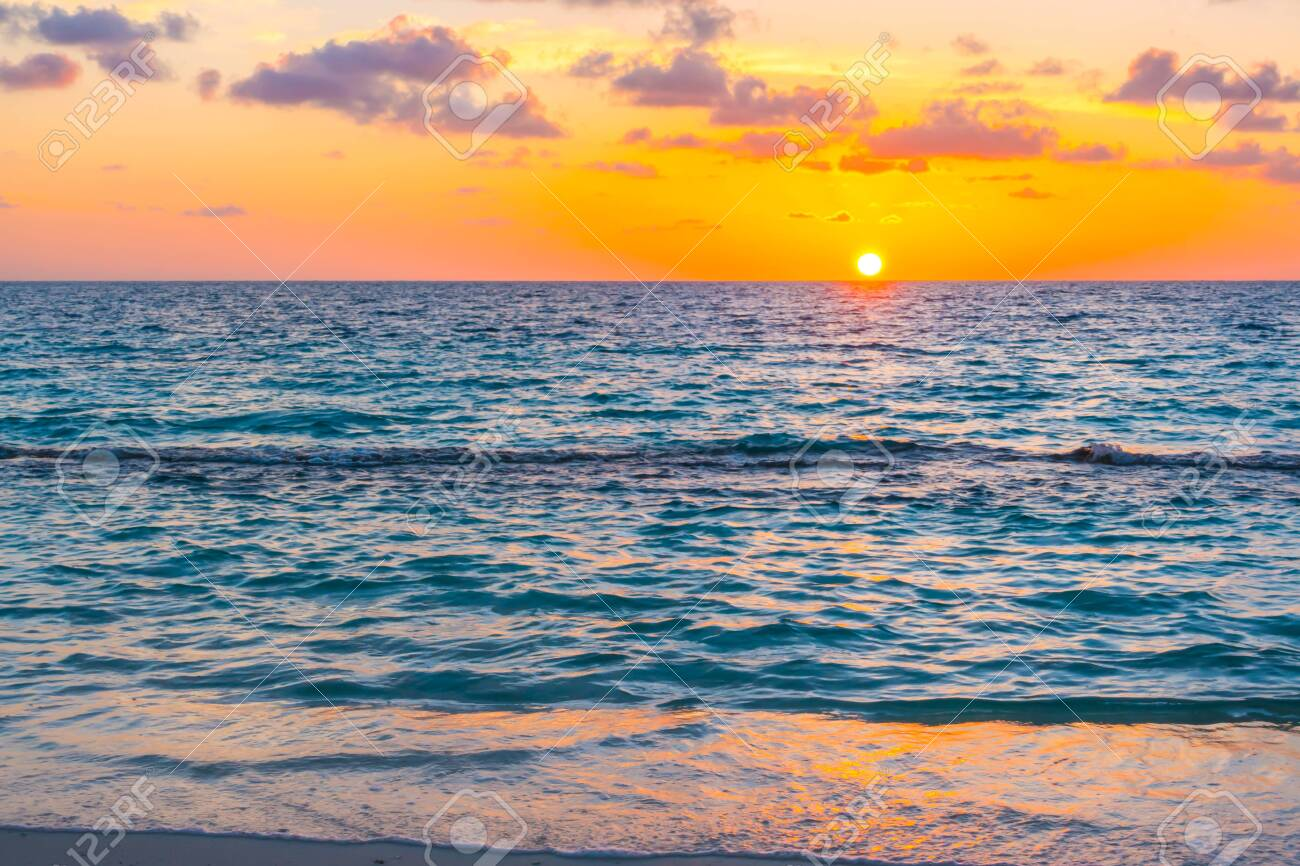 Beautiful sunset with sky over calm sea in tropical Maldives island - 124440456