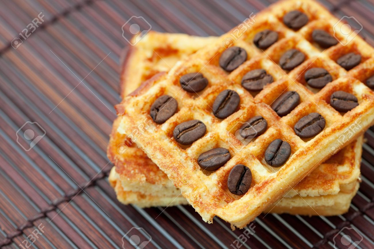 waffles and coffee beans on a bamboo mat Stock Photo - 7898233