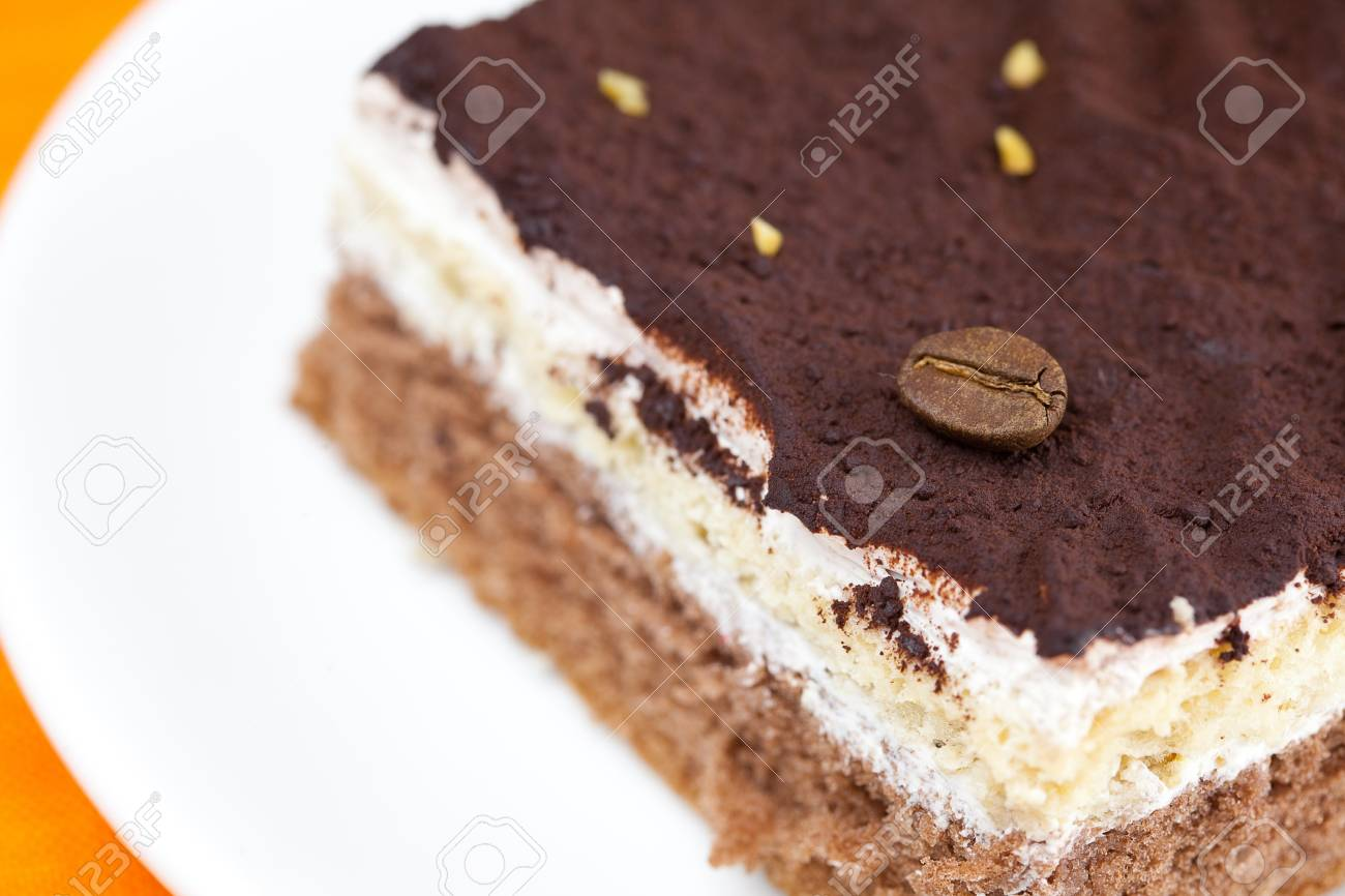 cake at the plate lying on an orange cloth Stock Photo - 8721573