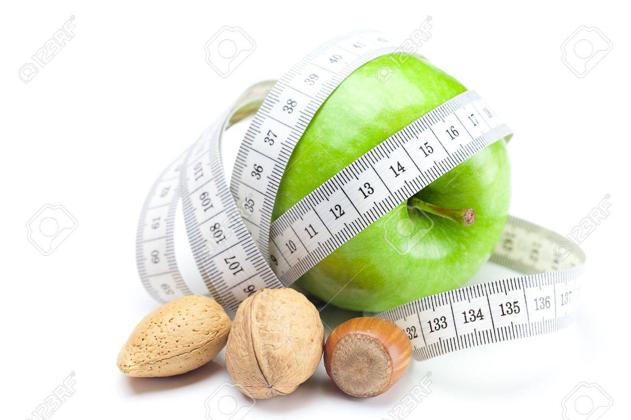 apple, nuts and measure tape isolated on white - 9037851