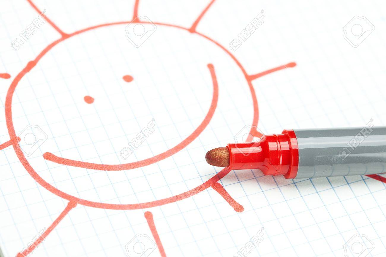 marker and painted the sun on the notebook sheet - 9038207