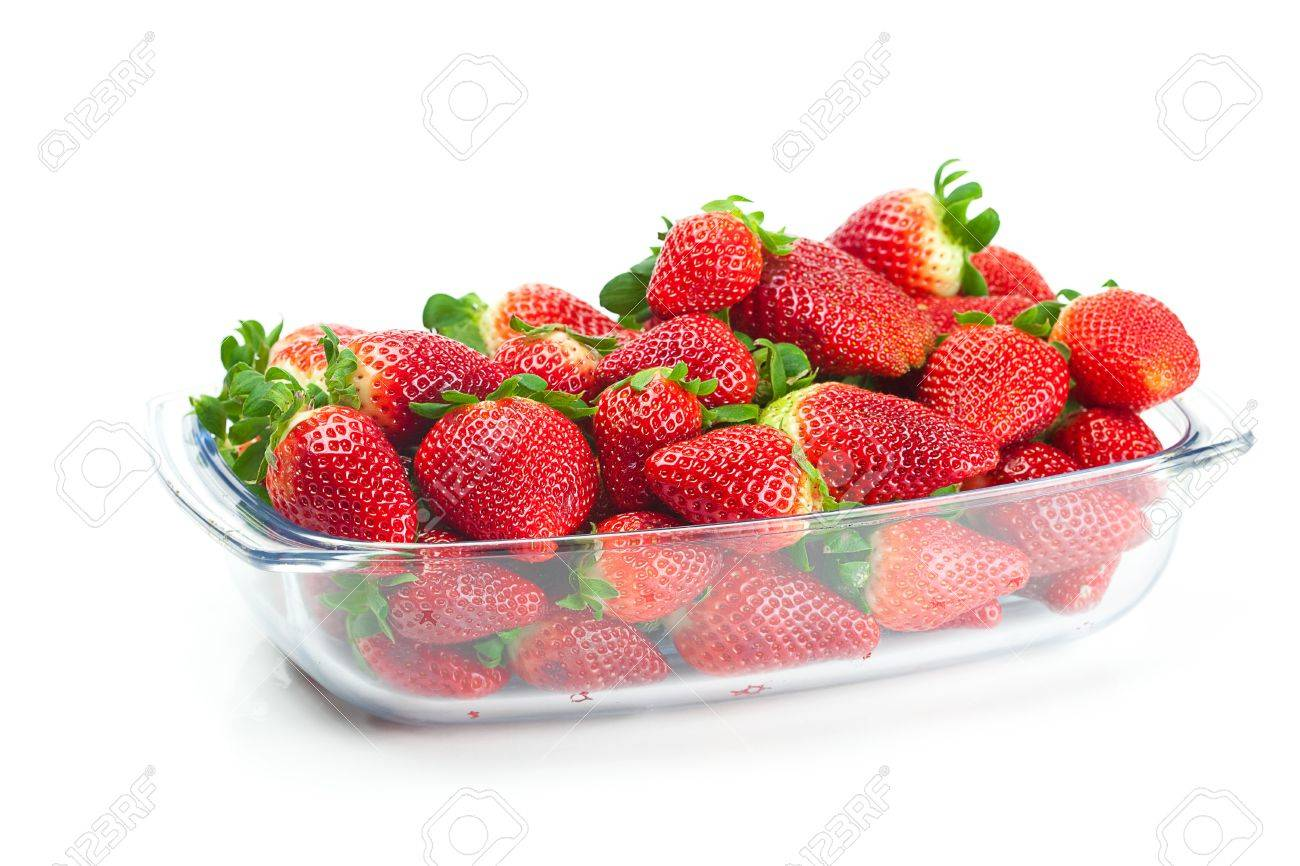 big juicy red ripe strawberries in a glass bowl isolated on white Stock Photo - 9084459