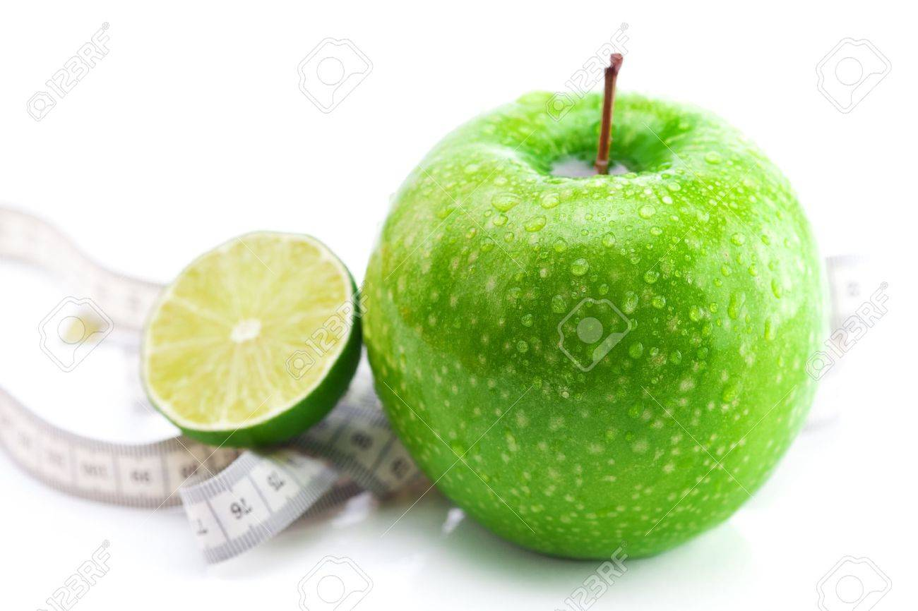 apple,lime and measure tape isolated on white - 9662872