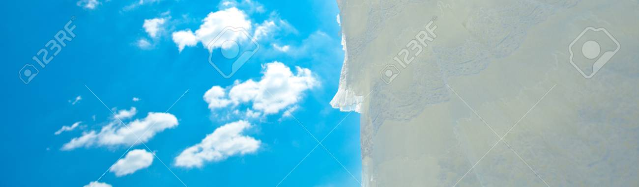 wedding dress and veil against the blue sky Stock Photo - 9995728