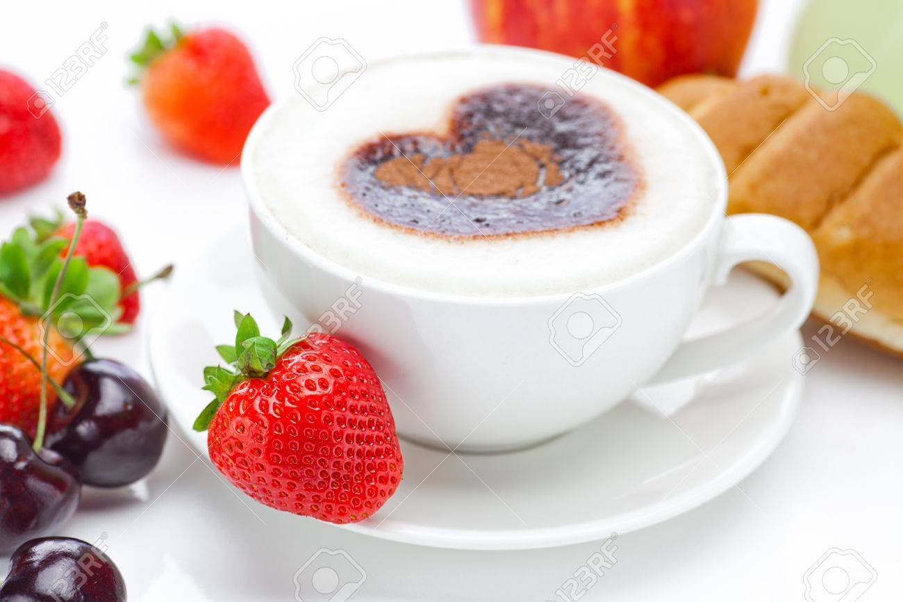 cappuccino in a cup in the shape of hearts,cherry,croissant  and strawberries isolated on white Stock Photo - 10617987