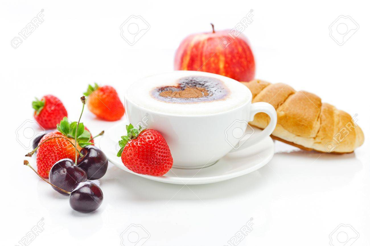 cappuccino in a cup in the shape of hearts,cherry,apple ,croissant and strawberries isolated on white - 11712395