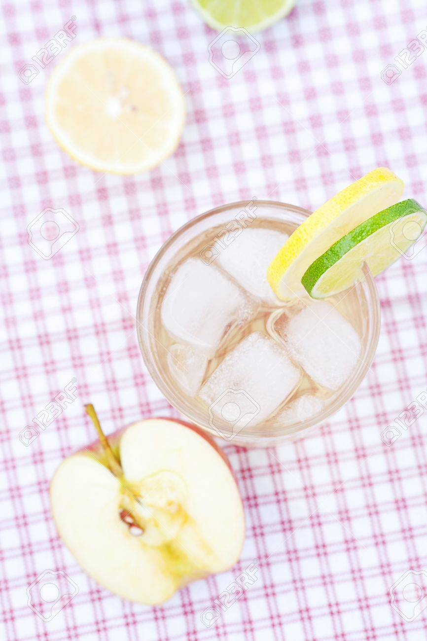 water with lemon and lime,apple in a glass with ice Stock Photo - 13747742