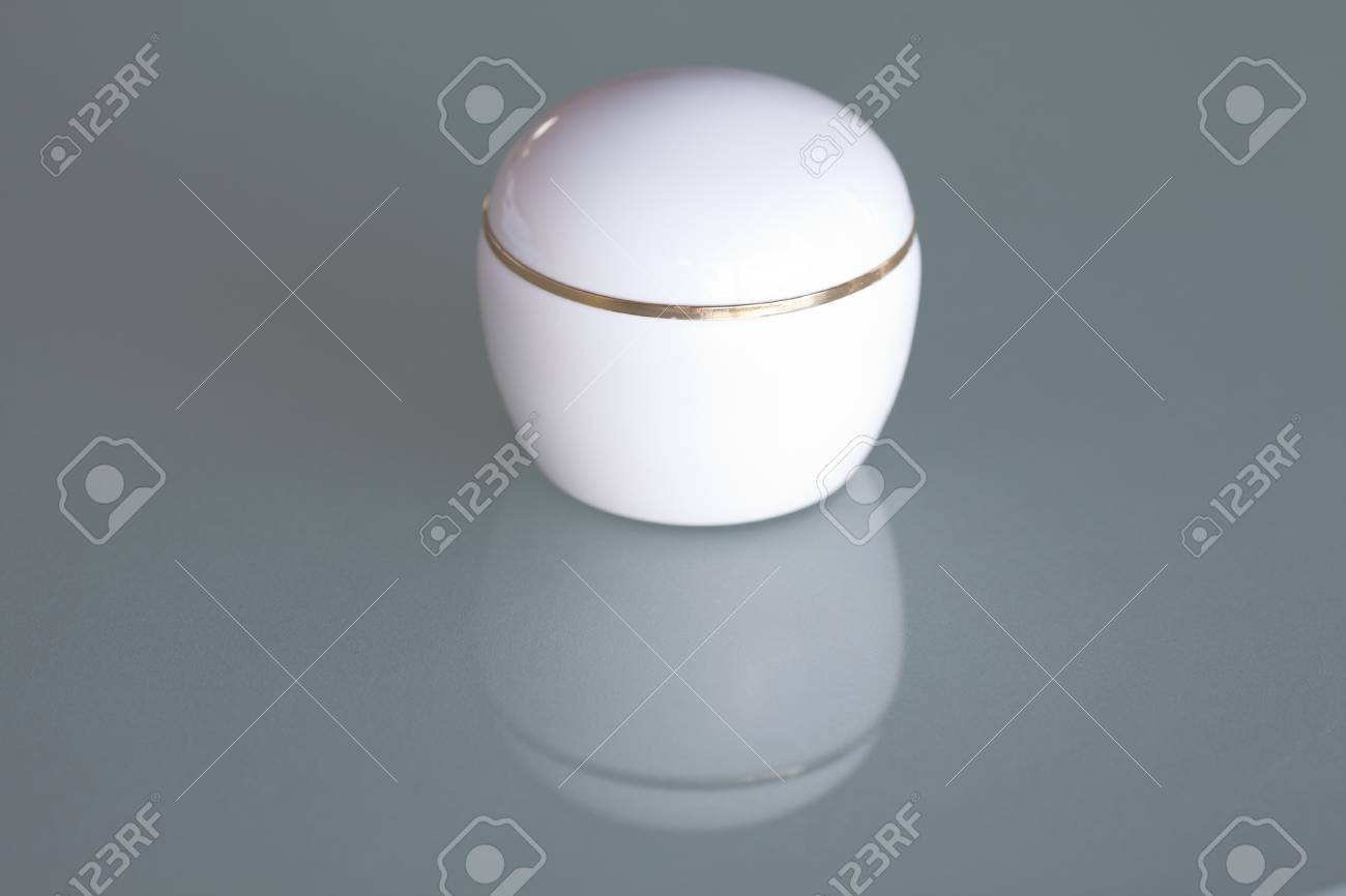 one cosmetic container on the glass surface Stock Photo - 13965636
