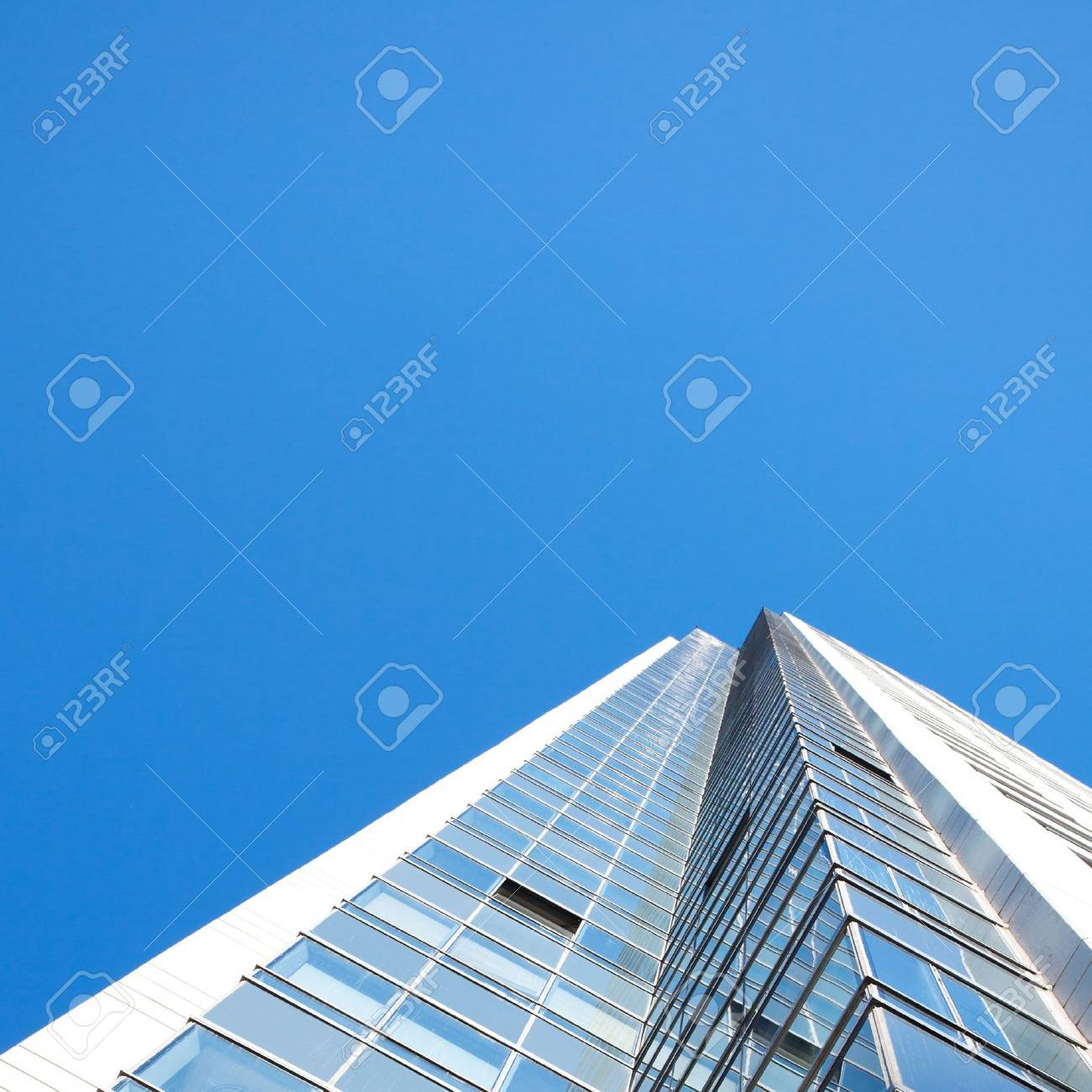 Beautiful modern office building against the blue sky - 13995107