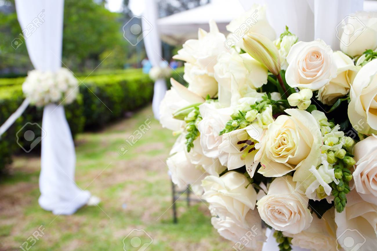 wedding marquee with bouquets of roses - 30322959