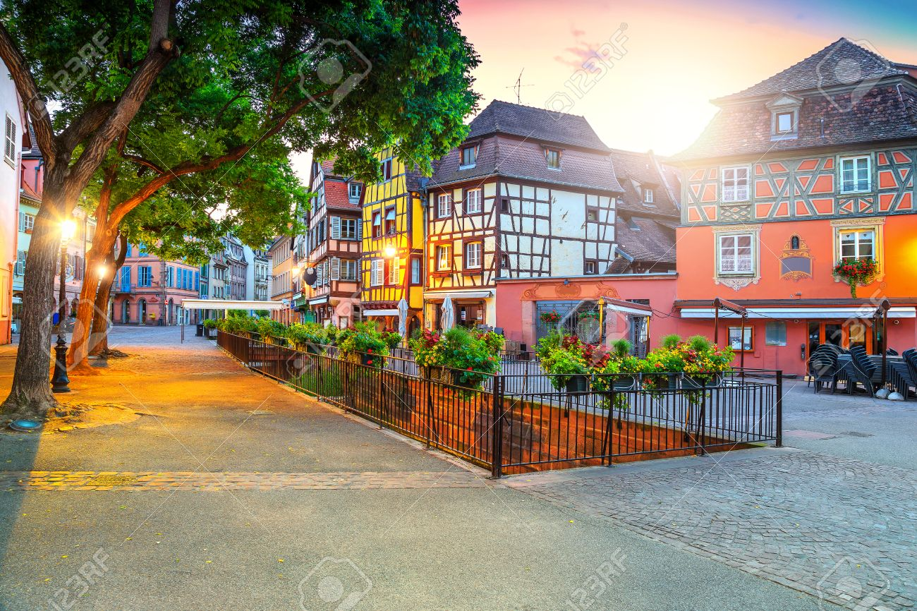Amazing Colorful Traditional French Houses And Decorated Street With Beautiful Flowers Colmar France