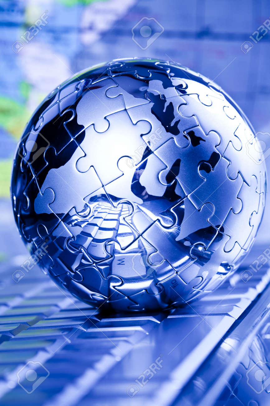 Notebook & puzzle earth globe Stock Photo - 5094411