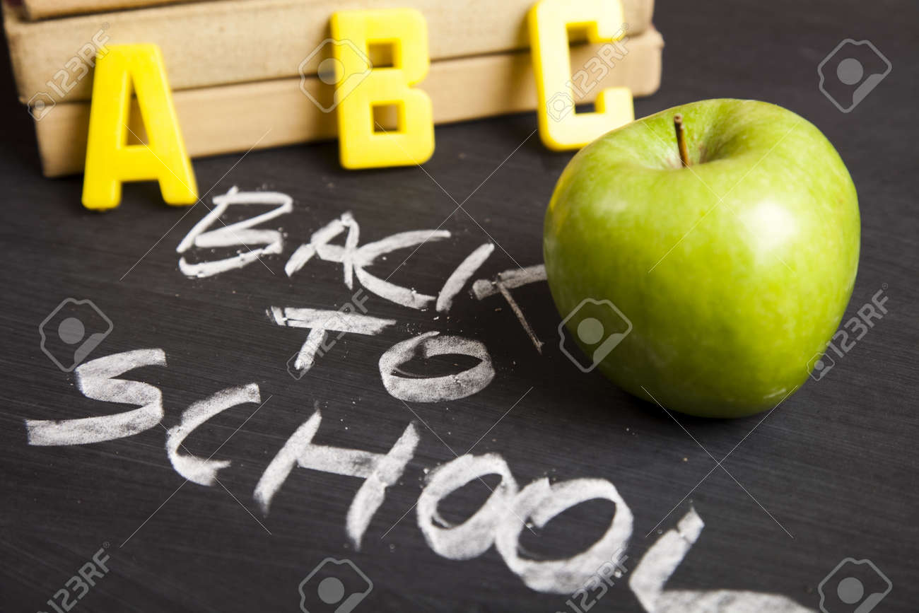 Apple on a blackboard Stock Photo - 5428728