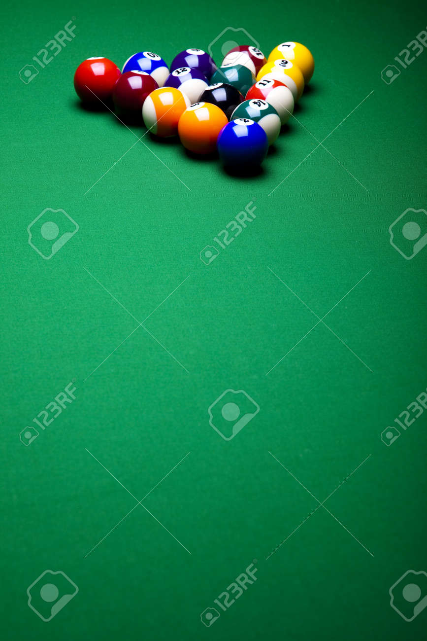 Pool game balls against a green Stock Photo - 8788909