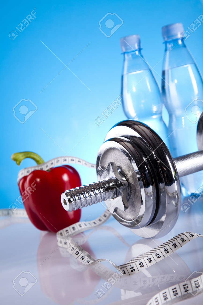 Dumbbell and bottle water Stock Photo - 9966990