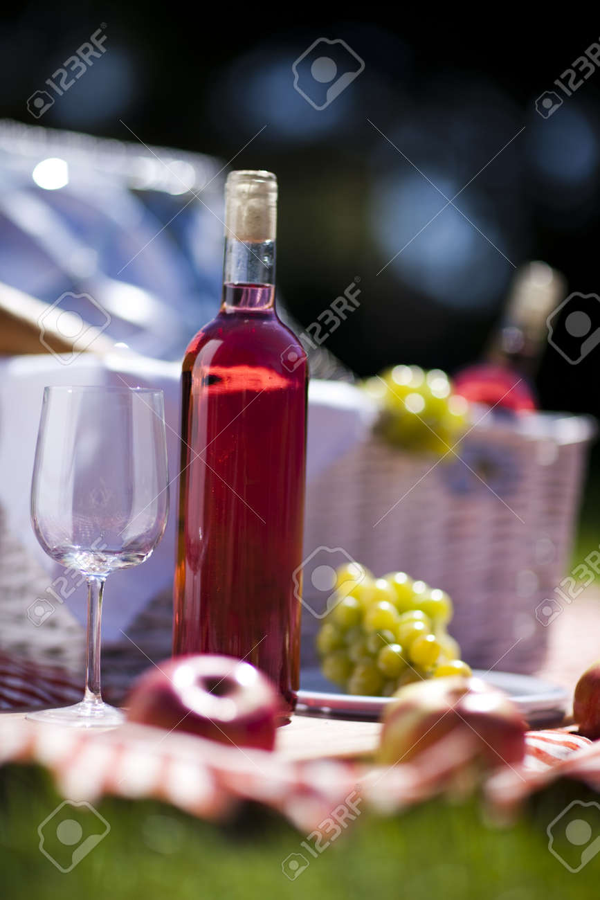 Wine and picnic basket on the grass Stock Photo - 15243563