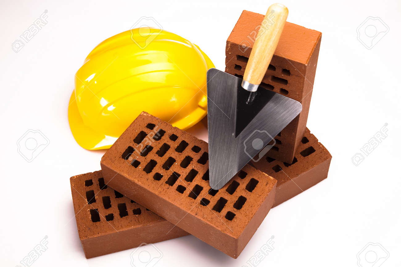 Brick, yellow hard hat, tools Stock Photo - 17487007