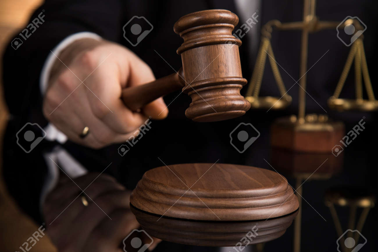 Judge, male judge in a courtroom striking the gavel - 134601665