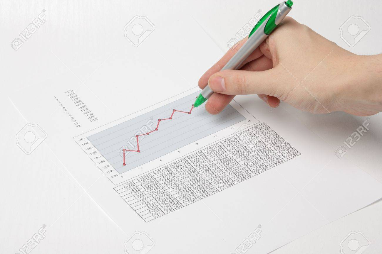 Hand with pen showing diagram Stock Photo - 2380009