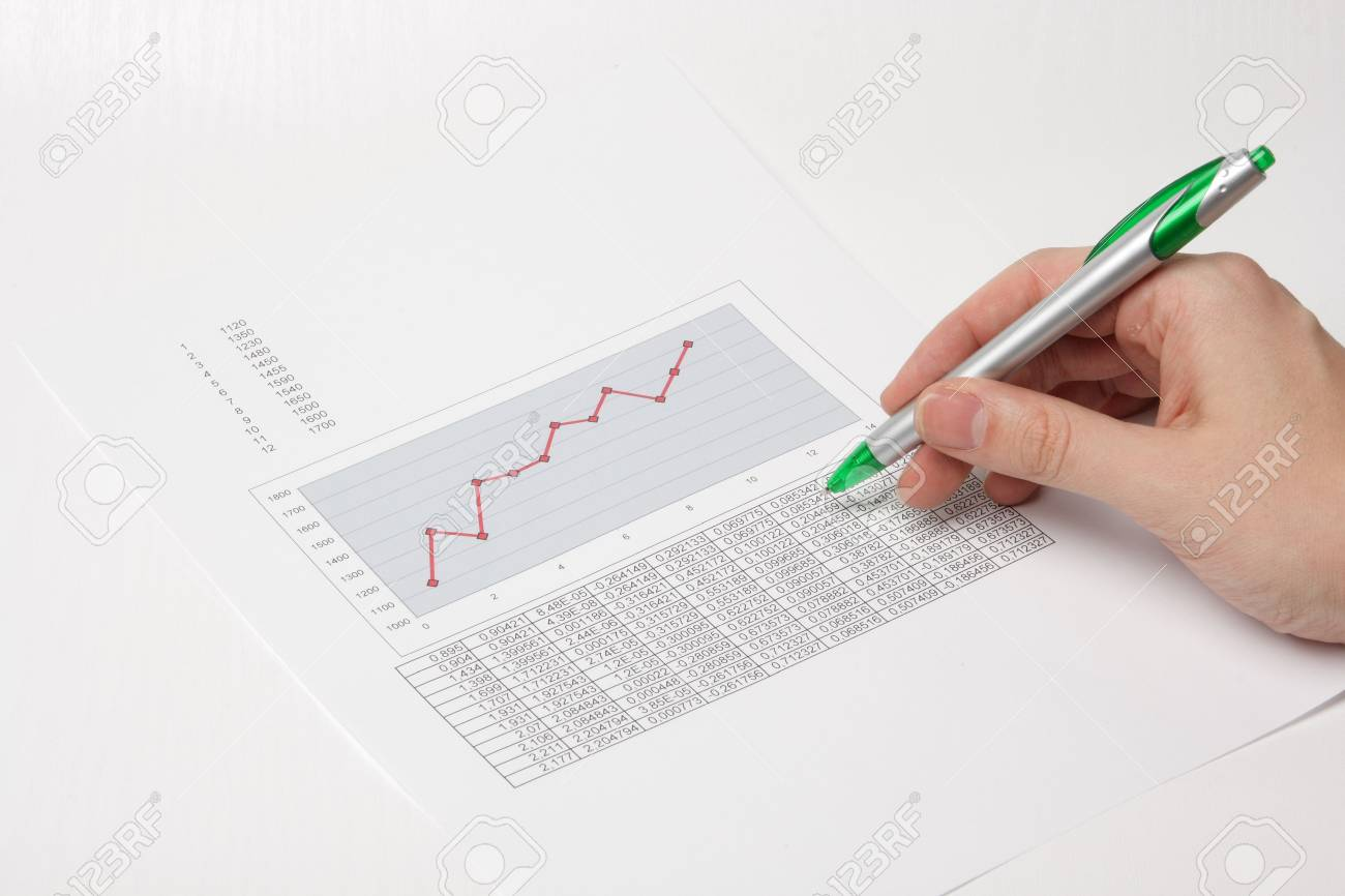 Hand with pen showing diagram Stock Photo - 2380008