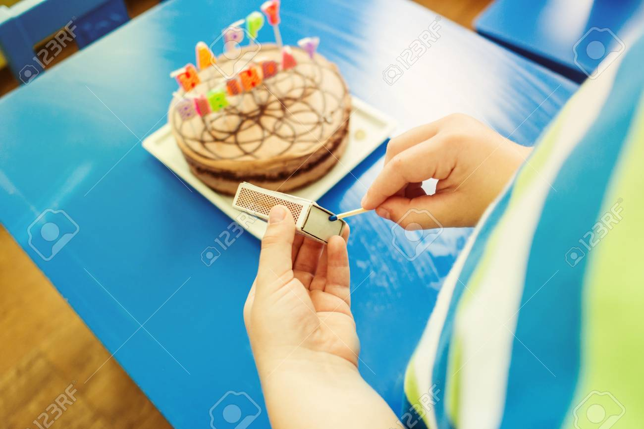 Birthday Party With Chocolate Cake Candles In Form Of Letters Young Boy Moving Around