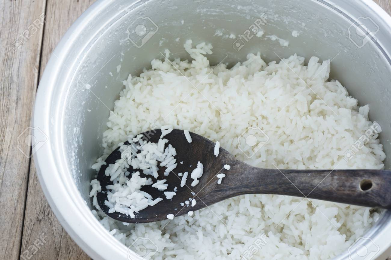 Jasmine Rice Cooking In Electric Rice Cooker Stock Photo Picture